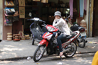 Hanoi<br /> , Vietnam - 2007 File Photo -<br /> <br /> A young vietnamese woman dressed in western clothes sit on a motorcycle in hanoi.<br /> <br /> <br /> <br /> photo : James Wong-  Images Distribution