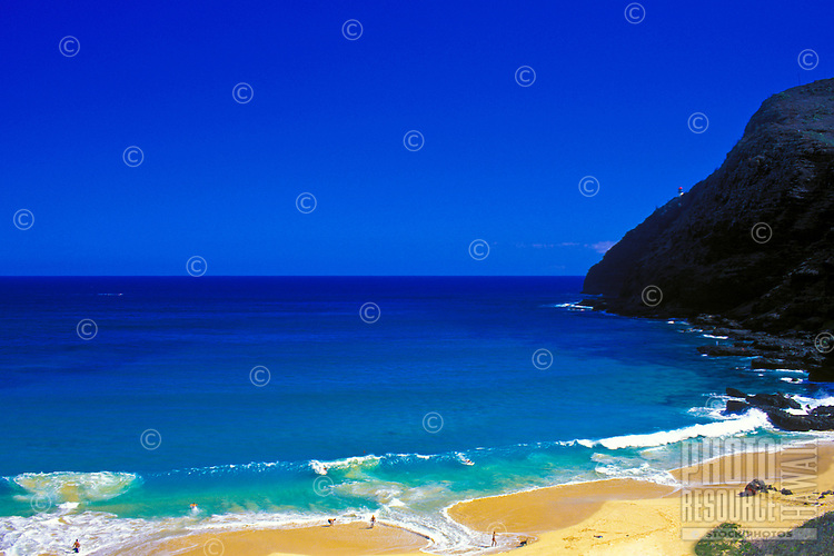 Famous Makapuu beach on Oahu's east side with large waves on a sunny winter day