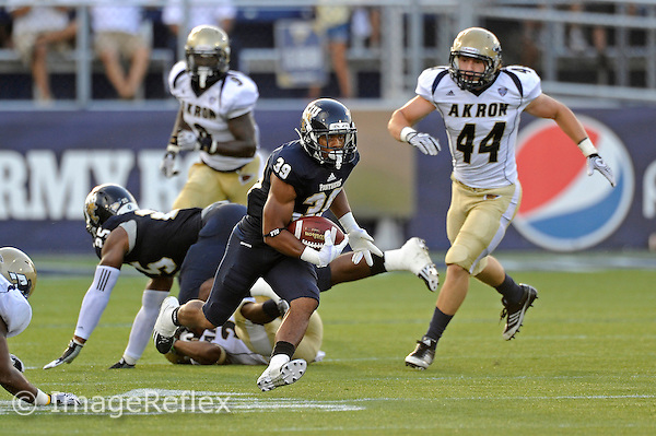 8 September 2012:  FIU cornerback Sam Miller (39) returns a punt in the first quarter as the FIU Golden Panthers defeated the Akron Zips, 41-38 (overtime), at FIU Stadium in Miami, Florida.