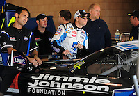 Oct. 10, 2009; Fontana, CA, USA; NASCAR Sprint Cup Series driver Jimmie Johnson (center) during practice for the Pepsi 500 at Auto Club Speedway. Mandatory Credit: Mark J. Rebilas-