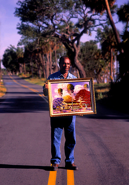 Portrait of a Highway Man, one of a group of artists called the Highway Men, who sold their distinctive artwork of Florida's natural beauty along the state's back roads in the 50's and 60's.  Today their artwork sells for thousands of dollars in art galleries all around the world.  Photographed for Coastal Living Magazine.
