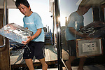 "Staff load food, drinks and ice for an evening aboard a ""Yakata-bune"" pleasure boat run by Harumiya Co. in Tokyo, Japan on 31 August  2010. .Photographer: Robert Gilhooly"