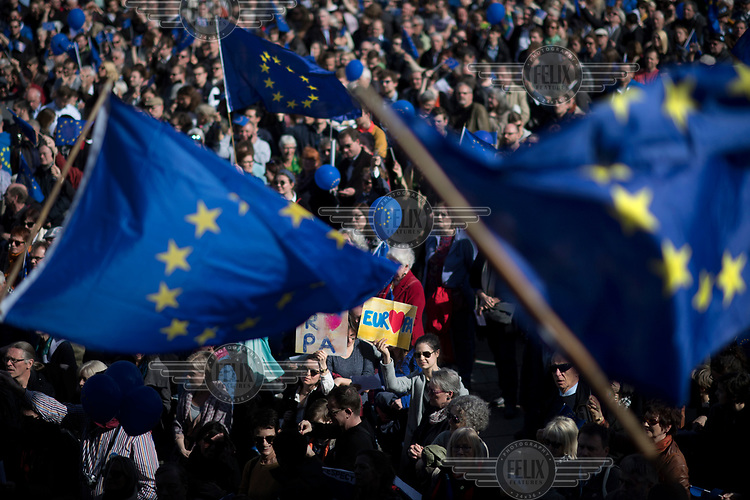 People wave EU flags at a pro-EU rally, the 'March for Europe', organised by the European Movement to celebrate the 60th anniversary of the Treaty of Rome.
