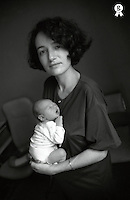 Portrait of mature woman with newborn baby (0-3 months), bw (Licence this image exclusively with Getty: http://www.gettyimages.com/detail/sb10065145by-001 )