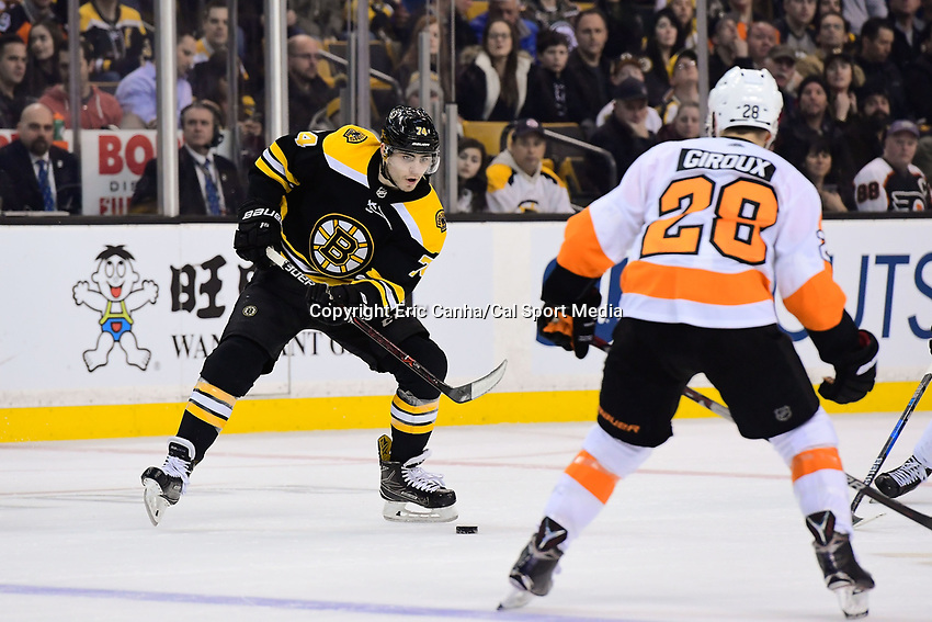 March 8, 2018: Boston Bruins left wing Jake DeBrusk (74) works the puck through the neutral zone during the NHL game between the Philadelphia Flyers and the Boston Bruins held at TD Garden, in Boston, Mass. Boston defeats Philadelphia 3-2 in regulation time. Eric Canha/CSM
