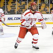 Adam Clendening (BU - 4) - The Harvard University Crimson defeated the Boston University Terriers 5-4 in the 2011 Beanpot consolation game on Monday, February 14, 2011, at TD Garden in Boston, Massachusetts.