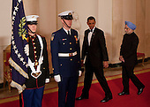 Washington, DC - November 24, 2009 -- United States President Barack Obama, second from right, and Manmohan Singh, India's prime minister, right, arrive to pose for a photograph in the Crosshall of the White House in Washington, D.C., U.S., on Tuesday, November 24, 2009. Obama welcomed India's role as a rising and responsible global power, saying the U.S. will follow through on a civilian nuclear agreement and work to expand trade and investment ties with the world's largest democracy. .Credit: Andrew Harrer - Pool via CNP