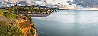 Sunset over Taranaki coastline with Three Sisters rock formation and Tongaporutu River, New Plymouth, Taranaki Region, North Island, New Zealand, NZ