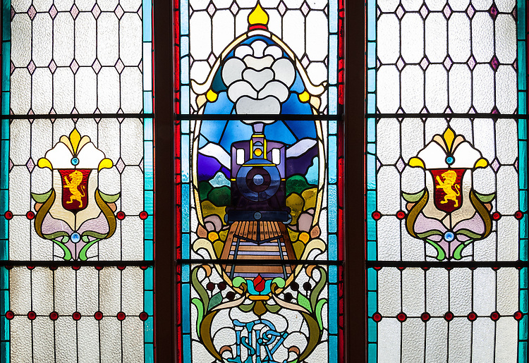 Stained Glass window with train motif at the Dunedin Railway Station, Otago, New Zealand - stock photo, canvas, fine art print
