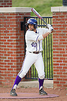 Tim Mansfield (40) of the High Point Panthers waits for his turn to bat against the Coastal Carolina Chanticleers at Willard Stadium on March 15, 2014 in High Point, North Carolina.  The Panthers defeated the Chanticleers 11-8 in game two of a double-header.  (Brian Westerholt/Four Seam Images)