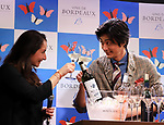 """April 19, 2018, Tokyo, Japan - Japanese actor Mokomichi Hayami (R) roasts with Pauline Dufour, Bordeaux winery staff at a promotional event of French Bordeaux wines in Tokyo on Thursday, April 19, 2018. Bordeaux wine bureau C.I.V.B. will have a three-day event """"My Bordeaux Party"""" to provide 100 selected brands Bordeaux wines with 300yen for a glass at a pop-up bar from April 20.  (Photo by Yoshio Tsunoda/AFLO) LWX -ytd-"""