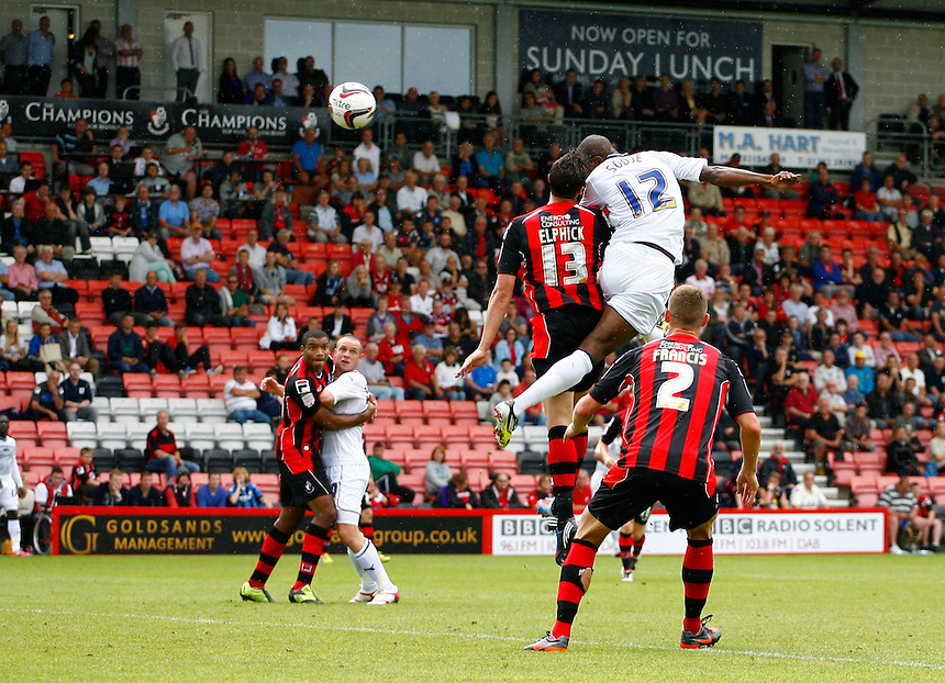 Preston North End's Akpo Sodje beats Bournemouth's Tommy Elphick to the ball and scores his sides first goal..Football - npower Football League Division One - Bournemouth v Preston North End - Saturday 25th August 2012 - Seward Stadium - Bournemouth..