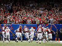 Ohio State fans celebrate an interception returned for a touchdown by defensive lineman Steve Miller (88) during the third quarter of the Allstate Sugar Bowl college football playoff semifinal against the Alabama Crimson Tide at the Mercedes-Benz Superdome in New Orleans on Jan. 1, 2015. (Adam Cairns / The Columbus Dispatch)