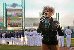 Whitney Myer sings the National Anthem before the triple-A minor league baseball game between the Reno Aces and the Colorado Springs Sky Sox on Thursday, April 5, 2012, in Reno, Nev. The Aces won their season opener 5-2..Photo by Cathleen Allison