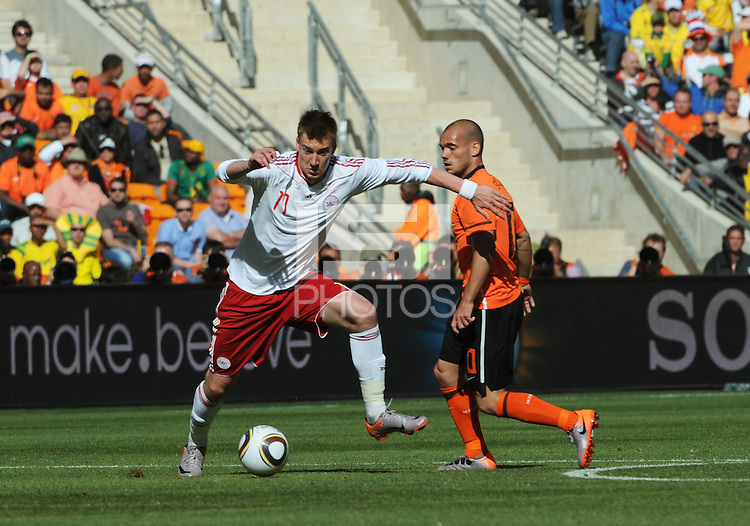 Danish forward Niklas Bendtner moves to space in setting up Denmark's attack. Holland defeated Denmark, 2-0, June 14th, at Soccer City in the opening match of Group E of the 2010 FIFA World Cup.