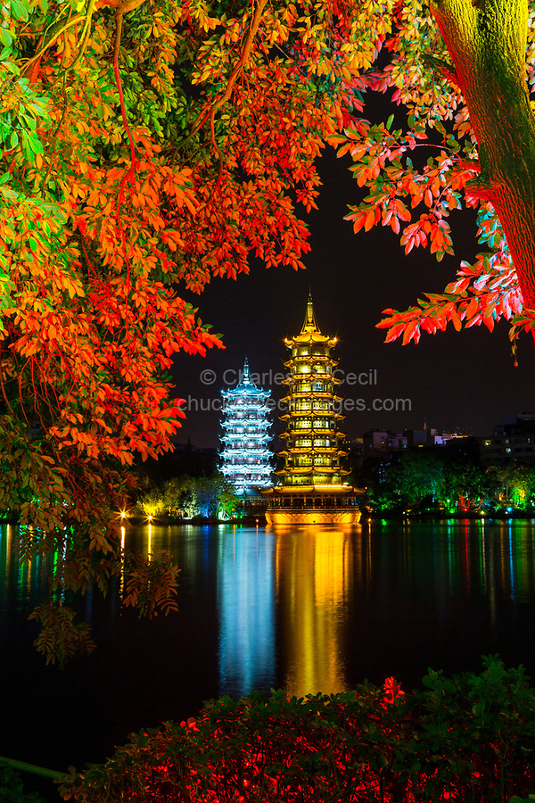 Guilin, China.  Sun and Moon Pagodas beside Shan Lake at Night.