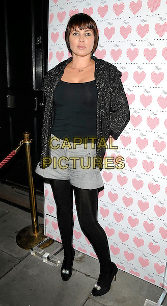 SADIE FROST .At the PRPS Heart Start Launch Party, Start Boutique, London, England, UK, .3rd September 2009..full length black top cardigan grey gray tights shorts patent shoes peep toe sparkly .CAP/CAN.©Can Nguyen/Capital Pictures