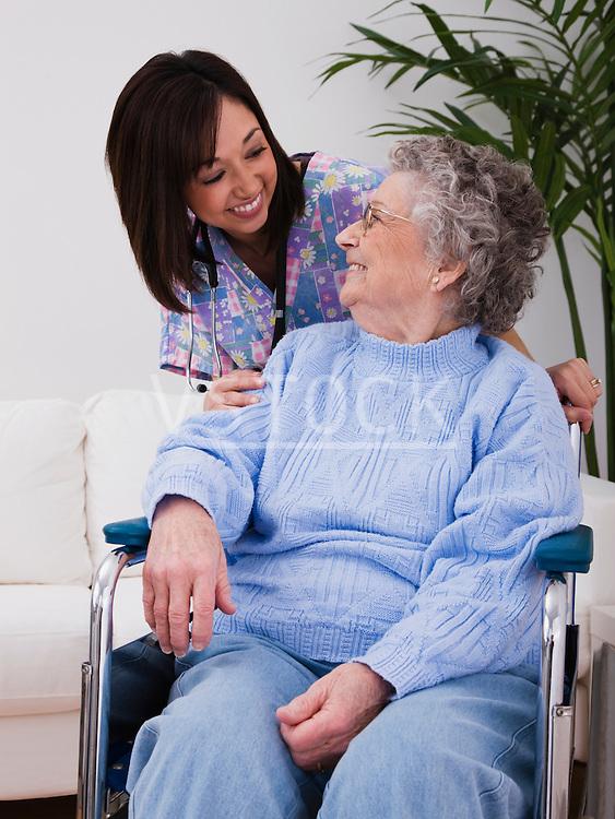 Female nurse with senior woman in wheelchair