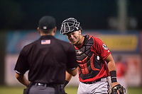 Billings Mustangs catcher Pabel Manzanero (47) laughs with home plate umpire Ethan McCranie during a Pioneer League game against the Idaho Falls Chukars at Melaleuca Field on August 22, 2018 in Idaho Falls, Idaho. The Idaho Falls Chukars defeated the Billings Mustangs by a score of 5-3. (Zachary Lucy/Four Seam Images)