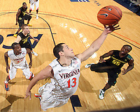 Dec. 17, 2010; Charlottesville, VA, USA; Virginia Cavaliers guard Sammy Zeglinski (13) grabs a rebound in front of Oregon Ducks guard Jay-R Strowbridge (55) during the game at the John Paul Jones Arena. Virginia won 63-48. Mandatory Credit: Andrew Shurtleff-
