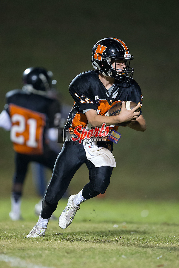 Sam Walker (12) of the Northwest Cabarrus Trojans runs with the football during second half action against the Concord Spiders at Trojan Stadium October 29, 2015, in Concord, North Carolina.  The Spiders defeated the Trojans 30-26.  (Brian Westerholt/Sports On Film)