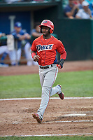 D'Shawn Knowles (4) of the Orem Owlz crosses the plate against the Ogden Raptors at Lindquist Field on August 3, 2018 in Ogden, Utah. The Raptors defeated the Owlz 9-4. (Stephen Smith/Four Seam Images)