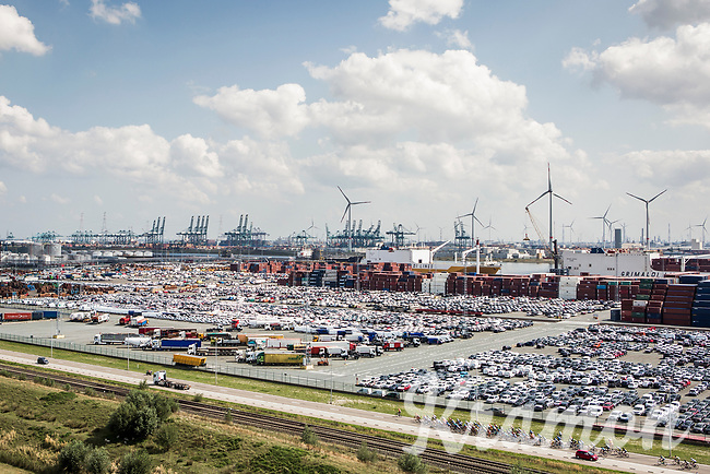 """Peloton riding though the Port of Antwerp. <br /> <br /> Antwerp Port Epic 2018 (formerly """"Schaal Sels"""")<br /> One Day Race: Antwerp > Antwerp (207km of which 32km are cobbles & 30km is gravel/off-road!)"""