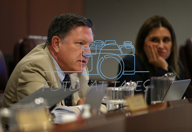 Nevada Assembly Republicans P.K. O'Neill and Victoria Seaman work in committee at the Legislative Building in Carson City, Nev., on Wednesday, April 29, 2015. <br /> Photo by Cathleen Allison