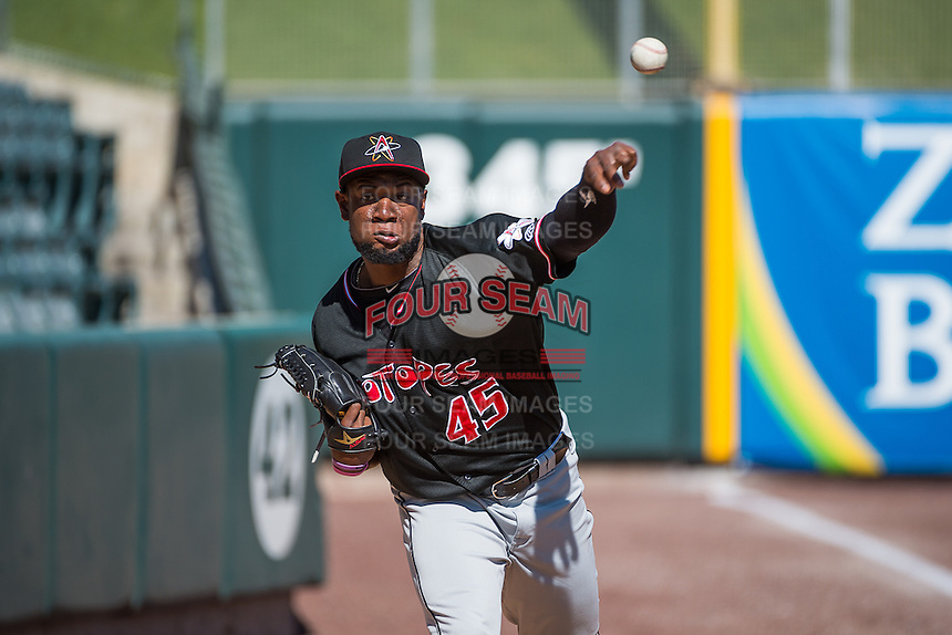 Yohan Flande (45) of the Albuquerque Isotopes warms up in the bullpen prior to the Pacific Coast League game against the Salt Lake Bees at Smith's Ballpark on June 8, 2015 in Salt Lake City, Utah. The Bees defeated the Isotopes 10-7 in game one of a double-header. (Stephen Smith/Four Seam Images)
