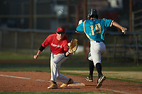 Lake Norman Copperheads first baseman Jakob Cohn (13) (Williams College) waits for a throw as Wade Chandler (19) (UNC Asheville) of the Mooresville Spinners hustles down the line at Moor Park on July 6, 2020 in Mooresville, NC.  The Spinners defeated the Copperheads 3-2. (Brian Westerholt/Four Seam Images)
