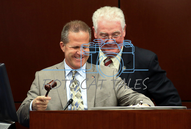 Nevada Lt. Gov. Mark Hutchison, left, and Assembly Speaker John Hambrick, R-Las Vegas, prepare for a speech by U.S. Sen. Dean Heller, at the Legislative Building in Carson City, Nev., on Monday, April 6, 2015. <br /> Photo by Cathleen Allison