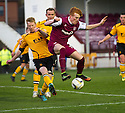 Annan's Steven Sloan clears from Arbroath's Simon Murray.