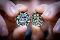 Tuesday 28 February 2017<br /> Pictured: The new one one pound coin along side the ' Round Pound ' <br /> Re: The Royal Mint in Llantrisant is producing the new one pound coin