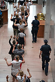 "Actress Susan Sarandon, center in the black and white striped shirt, is led out of the Hart Senate Office Building by United States Capitol Police as she joins the ""Women's March in Civil Disobedience to End Family Detention"" in Washington, DC on Thursday, June 28, 2018.  <br /> Credit: Ron Sachs / CNP<br /> (RESTRICTION: NO New York or New Jersey Newspapers or newspapers within a 75 mile radius of New York City)"