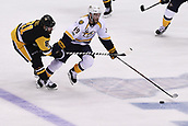 8th June 2017, Pittsburgh, PA, USA; Nashville Predators center Calle Jarnkrok (19) skates with the puck as Pittsburgh Penguins right wing Phil Kessel (81) defends during the third period. Game Five was won 6-0 by the Pittsburgh Penguins against the Nashville Predators during the 2017 NHL Stanley Cup Final on June 8, 2017, at PPG Paints Arena in Pittsburgh, PA. The Penguins take a 3-2 series lead in the best of seven series with the victory.