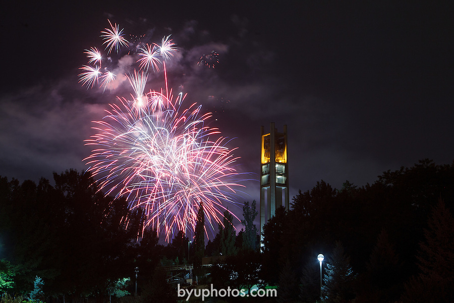 1207-05 47 GCS Bell Fireworks<br /> <br /> Fireworks from the stadium of fire behind the Bell Tower.<br /> <br /> July 4, 2012<br /> <br /> Photo by Jonathan Hardy/BYU<br /> <br /> © BYU PHOTO 2012<br /> All Rights Reserved<br /> photo@byu.edu  (801)422-7322