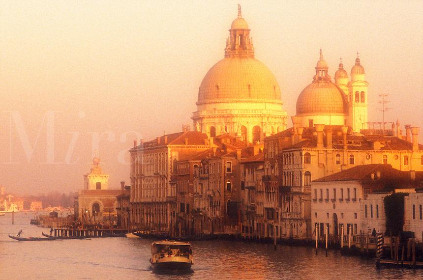Italy, Venice. The Grand Canal with Santa Maria della Salute and a vaporetto