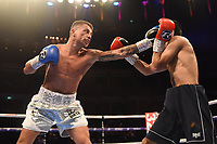 Lucien Reid (white/silver shorts) defeats Indi Sangha during a Boxing Show at the Royal Albert Hall on 8th March 2019