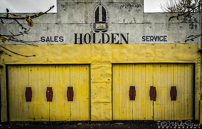 An old garage and vintage signage in the quaint historic town of Ross on the Heritage Highway in Tasmania, Australia.