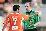 02 June 2012: Carolina's Austin da Luz (7) has words with Assistant Referee Ben Jackson. The Carolina RailHawks defeated the Puerto Rico Islanders 2-1 at WakeMed Soccer Stadium in Cary, NC in a 2012 North American Soccer League (NASL) regular season game.