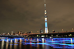 "May 25, 2013, Tokyo, Japan - Some 100,000 blue LED light bulbs floats down the Sumida river during an event ''Tokyo Hotaru Festival 2013'' in Tokyo on Saturday night, May 25, 2013. The world's tallest broadcasting tower marked the first anniversary of its opening. People enjoyed a spectacle of a different sort as thousands of electric ""fireflies"" with the new landmark. (Photo by Masahiro Tsurugi/AFLO)"