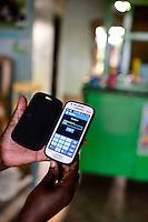 KENIA, County Siaya, village Kotanega, M-Pesa payment by mobile phone / KENIA, bezahlen per Mobiltelefon, M-Pesa von Safari.com a joint venture of Vodafone and kenyan telephone