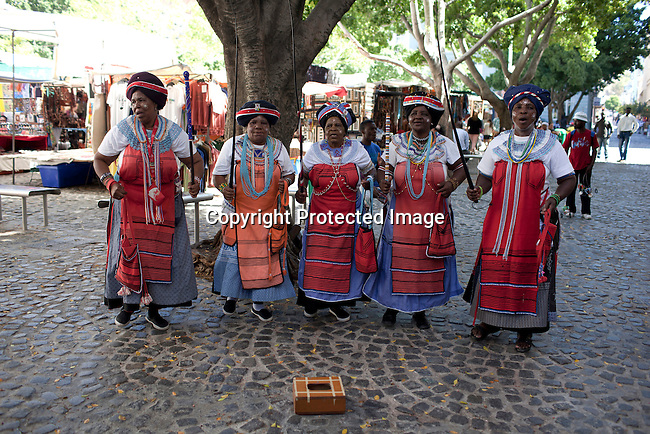 CAPE TOWN, SOUTH AFRICA - MARCH 21: Xhosa ladies perform a traditional dance and song at Greenmarket Square market area on March 21, 2012 in Cape Town, South Africa (Photo by Per-Anders Pettersson For Le Monde)