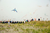 USA, Washington State, Long Beach Peninsula, International Kite Festival, launching a kite on the grassy dunes at the kite festival