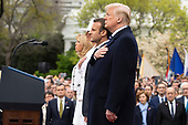 United States President Donald J. Trump, French President Emmanuel Macron, first lady of the United States Melania Trump, and first lady of France Brigette Macron  stand for the United States National Anthem on the South Lawn of the White House during the French State Visit to the United States on April 24, 2018 in Washington, DC. Credit: Alex Edelman / Pool via CNP