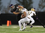 SIOUX FALLS, SD, OCTOBER 8:  Connor Schoepp #35 from the University of Sioux Falls brings down Max Simmons #28 from Southwest Minnesota State University in the first half Saturday night at Bob Young Field. (Photo by Dave Eggen/Inertia)
