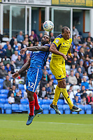 Anthony Grant of Peterborough United and Wes Thomas of Oxford United in an aerial battle during the Sky Bet League 1 match between Peterborough and Oxford United at the ABAX Stadium, London Road, Peterborough, England on 30 September 2017. Photo by David Horn.