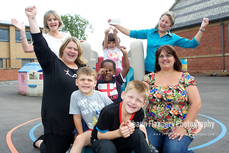 Pix: Shaun Flannery/shaunflanneryphotography.com...COPYRIGHT PICTURE>>SHAUN FLANNERY>01302-570814>>07778315553>>..2nd August 2010.............Miller Homes, Millenium Village, Allerton Bywater..Miller Homes Jan Hanbury (back left) & Maureen Stephen (back right) join youngsters at ABC and Ozone child care to hand over a cheque for £250.00.Also pictured L-R are Sara Dean, Nursery Manager, Alex Lane, Ethan Bajulaiye, Saski Lane, Alfie Dean, Helen Lane, Chair of Trustees.