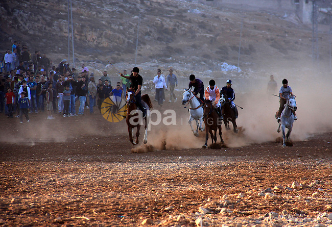 Palestinian jockeys ride their horses during a race in the West Bank city of Nablus on Dec. 3, 2010. Hundreds of Palestinians from all over the West Bank gathered to follow the horse race on Friday in the northern West Bank city. Photo by Wagdi Eshtayah