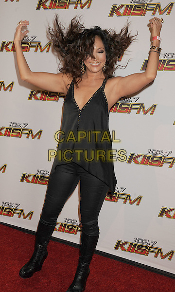 Carrie Ann Inaba.The 102.7 KIIS FM's Jingle Ball at the Nokia Theatre L.A. Live in Los Angeles, California, USA..December 3rd, 2011.full length black dress tights trousers boots hands arms in air flick flicking hair funny gesture .CAP/ROT/TM.©Tony Michaels/Roth Stock/Capital Pictures